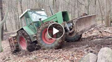 Fendt 612 hard climbing uphill in forest