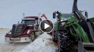 Picking up grain bags & sledding